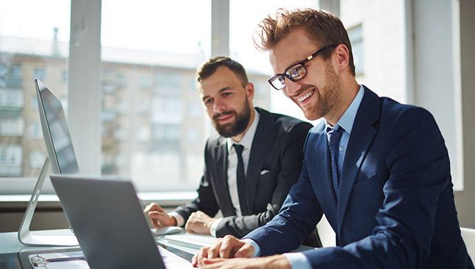 Stock image of two business men for the